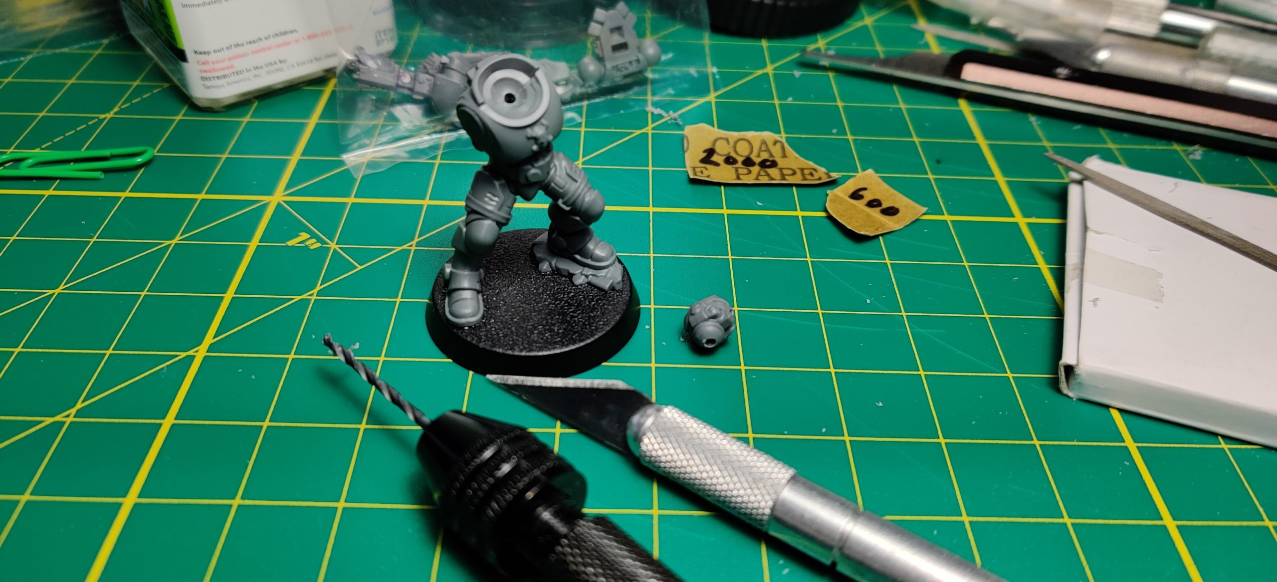 Primaris Space Marine Infiltrator/Incursor with holes drilled in top of torso and bottom of neck for magnets.
