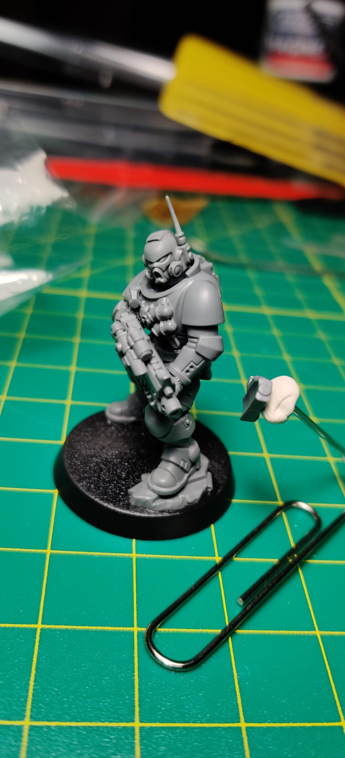 Primaris Space Marine Infiltrator/Incursor with Sticky Tac and paperclip placement tool.